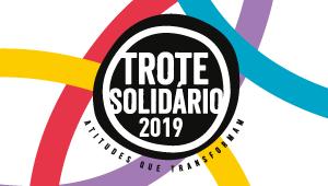 Logo do Trote Solidário de 2019. Ela é redonda e preta.